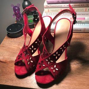 MK ruby red heels
